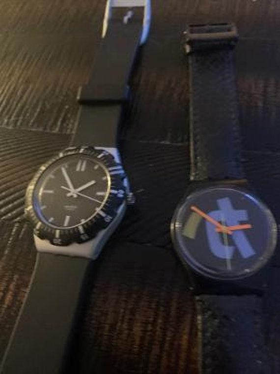 2 swatch black watches