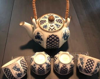Vintage Japanese teapot with four cups