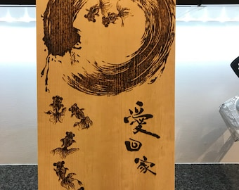 Wood burning happy fishes in zen circle pyrography