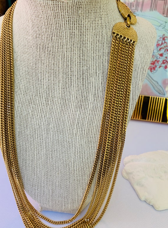 Vintage 1970's gold multi chain, elegant necklace.