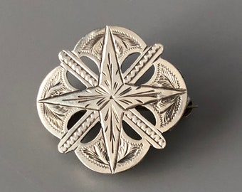 Dainty silver brooch
