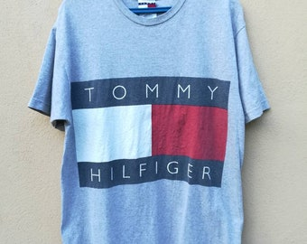 da1e41eaaa7 Vintage 90s Tommy Hilfiger Big Logo Spell Out TShirt Medium Size Made in USA