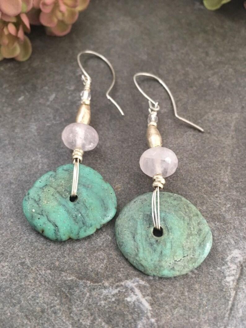 Boho chic gemstone earrings .