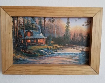 Cabin with bridge and canoe