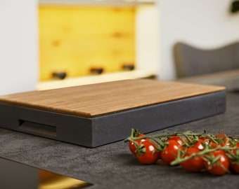 Premium cutting board 2in1 by Ovisproducts made of bamboo, corian & concrete