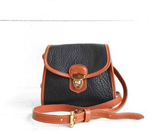 "Vintage Dooney and Bourke AWL ""The Little Bag"" Small Shoulder Bag Black/Dark Navy Leather with British Tan Trim"