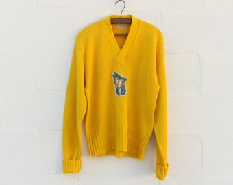 MED-LRG | 1970's Bright Yellow V-Neck Sweater w/ Captain Patch Applique' on Keller Sports
