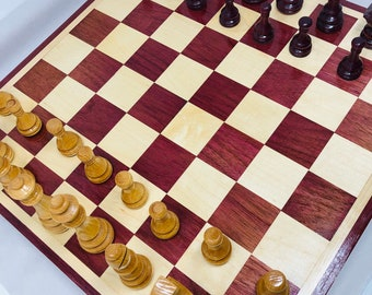 Beautiful handmade chess set complete with chessmen.  Made of Purple Heart and Maple hardwoods