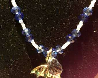 Blue glass necklace with umbrella charm