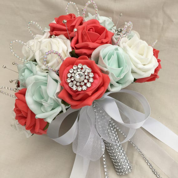 Artificial Wedding Flowers, Brides Posy Bouquet with Coral, Mint Green and White Roses with brooches, crystals and diamantes