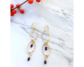 Gold filled chain wirew rapped with garnet
