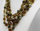 Signed Miriam Haskell Triple Strand Crystal Glass and Faux Pearl Beaded Necklace with Brass Filagree Beads Circa 1950
