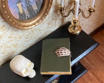 1/12 scale dolls house miniature accessories large reclaimed leather covered book with skeleton hand. Witch Halloween