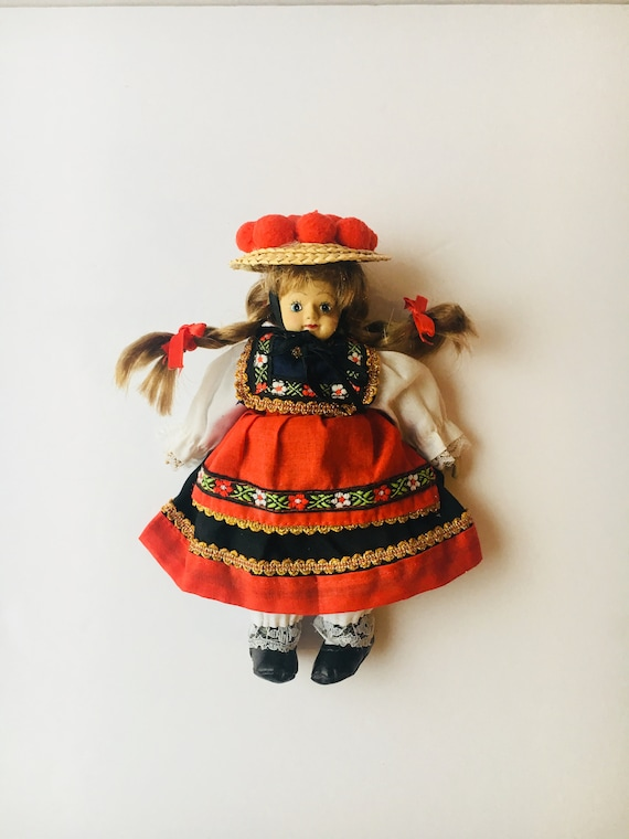 Black Forest Germany doll wearing traditional Bollenhut Hat