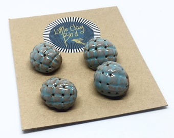 Set of 4 ceramic buttons