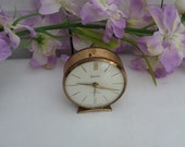 Swiza 7 Jewel alarm clock, small round Swiss made vintage working manual wind up clock in gold tone case