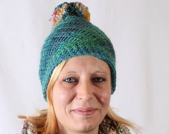 hand knit hat with glitter yarn and pompom