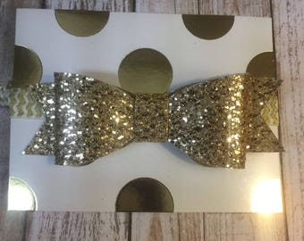 Large Gold fabric bow, aligator clip or eslatic head band .
