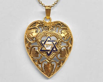 14K Yellow Gold heart shaped filigree Pendant/Charm with a central blue and white enameled Star of David centered with a Hebrew inscription