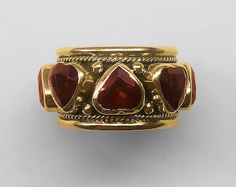 Vintage 14K Yellow Gold band ring bezel set with 8 heart shaped Garnets and decorated with Gold granulation and twisted Gold rope trim