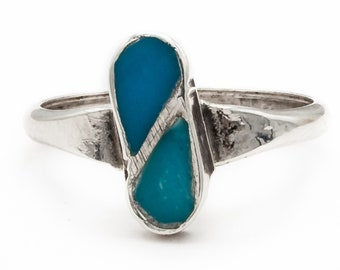 Sterling Silver Vintage ring inlaid with two pear shaped natural Turquoise.