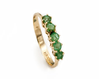 Emerald Stacking Ring: 14K Yellow Gold engagement / wedding ring prong set with 5 matched natural round faceted Emeralds. Estate circa 1970