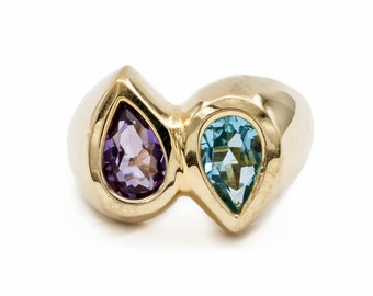 Twin teardrop bezel set fine Amethyst and beautiful Blue Topaz engagement / cocktail ring of 14K Yellow Gold. One of a kind and handmade.