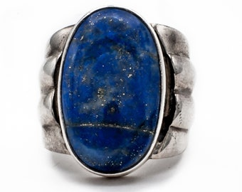 Luscious Bohemian style oval Lapis Lazuli Statement Ring in Sterling Silver accented with a scalloped edge.