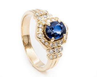 18K Yellow Gold ladies engagement / dinner ring prong set with one oval Ceylon Blue Sapphire and 28 bead & bezel set Diamonds. Low Profile.