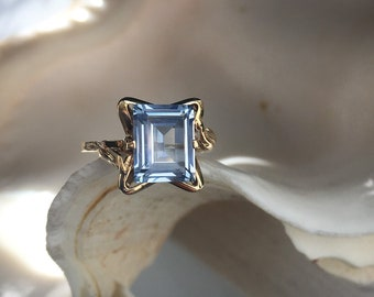 Vintage 1950's never worn Engagement/Dinner Ring; 10K Yellow Gold set with a step cut synthetic Aquamarine; mid-century design at its finest