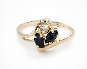 Unique one-of-a-kind 14K gold swirl motif ladies engagement / dinner ring prong set w/ two marquis-cut natural blue Sapphires & one Diamond.