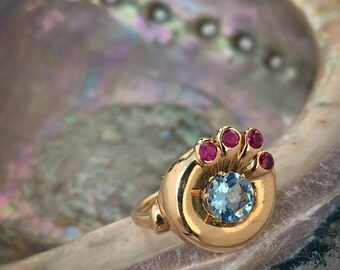 Vintage retro motif 14K Pink Gold Peacock Ring circa 1940 prong set with a fine natural diamond cut Aquamarine and 4 bezel set round Rubies