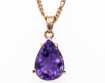 Utter simplicity in 18K solid rose-gold set with a gorgeous Siberian pear shaped Amethyst weighing approximately 6 carats