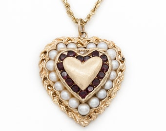 Heart shaped locket of 14K Yellow Gold with fine Akoya Pearls and Garnets. Exceptionally Heavy. Engravable. Vintage & Pristine circa 1960.