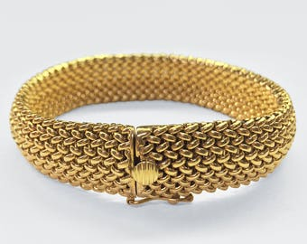 14K Yellow Gold heavy tailored Woven Bracelet which is slightly convex and has a box catch and additional safety catch