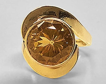 Diamond cut 14 millimeter round Golden Green Smoky Topaz bezel set in a handmade extra heavy 14K Yellow Gold Ring from the 1950's