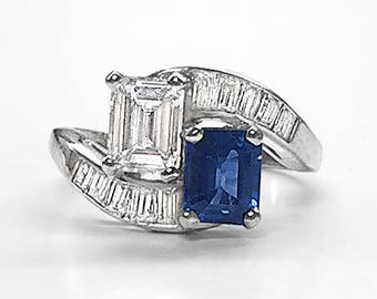 Vintage Platinum Bypass Engagement/Cocktail Ring set with fine natural Blue Sapphire & 1.03 Ct Emerald Cut Diamond; 10 channel set Baguettes