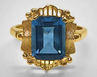 10K Yellow Gold vintage Ring; pierced and Florentine engraved design in an antique style set with a beautiful step cut synthetic Blue Zircon