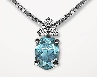 14K White Gold vintage Pendant prong set with fine Natural Aquamarine and 3 brilliant cut Diamonds on a substantial Box Chain; secure catch