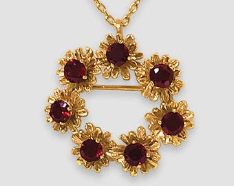 "14K Yellow Gold vintage Pin/Pendant in a circular pattern composed of 7 ""Daisy"" motifs each centered with a lovely prong set faceted Garnet"