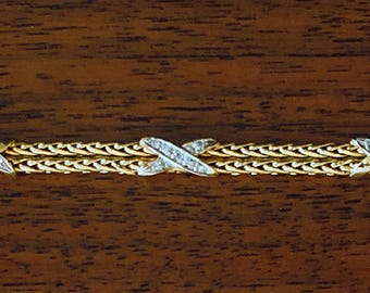 "14K Yellow Gold Tiffany-like flexible link Bracelet with 3 Diamond encrusted White Gold ""X"" overlays"