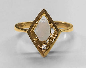 Charming estate oval Australian Opal and Diamond angular motif sculptural 14K Yellow Gold Ring