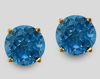 The birthstone for December, 14K Yellow Gold fine Blue Topaz Stud Earrings (7 & 8 millimeters shown), available in any size