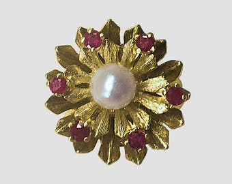 Florentined Floral Ring of 14K Yellow Gold set with a 6.5 mm top quality Akoya Cultured Pearl and 6 fine Rubies circa 1958