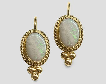 14K Yellow Gold Lever-back Earrings bezel set with lively oval Australian Opals accented with twisted rope trim and granulated Gold