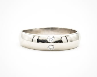 Handmade 14K White Gold knife-edge Ring set with two fine brilliant cut diamonds (8/100 carat)
