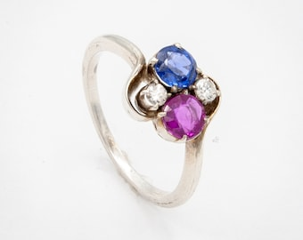 14K White Gold Engagement ring prong set with fine round Ruby and Sapphire; Vintage ring with 2 Brilliant cut Very Fine Diamonds. c.1915.