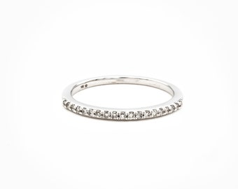 Minimalist Brilliance in this 10K White Gold wedding band or stacking ring set with a row of 21 fine diamonds totaling 1/5 of a carat
