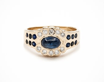 Handmade Stunning Cigar Band Engagement Ring of 14K Gold set with gem-quality Cabochon Ceylon Blue Sapphires and brilliant cut diamonds