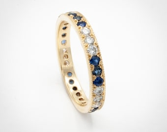 14K Yellow Gold Handmade Eternity style wedding ring pave set w/ 15 Sapphires and 15 Diamonds totaling 112/100 carats. Perfectly Stackable